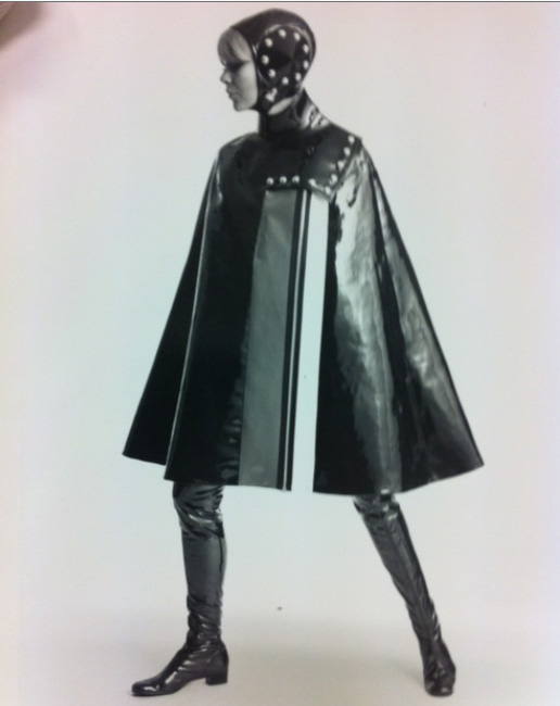 Photograph of young women in PVC cape and thigh-length boots, designer unknown,1963-69, SA/AT/26/12/26