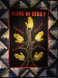 MORE or LESS?, quilted wall hanging created by older women from the Brixton community, 2011.