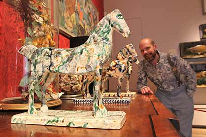 Mark Hearld with ceramic horses in The Lumber Room, York Art Gallery, 2015