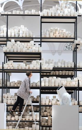 Clare Twomey with her installation Manifest: 10,000 Pots, York Art Gallery, 2015