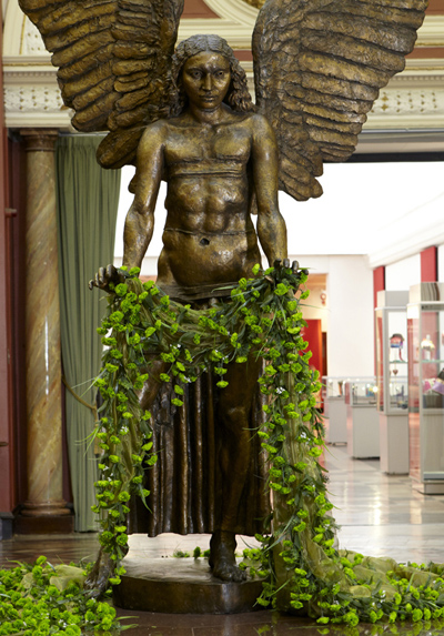 Jacob Epstein and Matt Smith, Lucifer holding a cape of green carnations, on display as part of Queering the Museum, Birmingham Museum and Art Gallery, 2010
