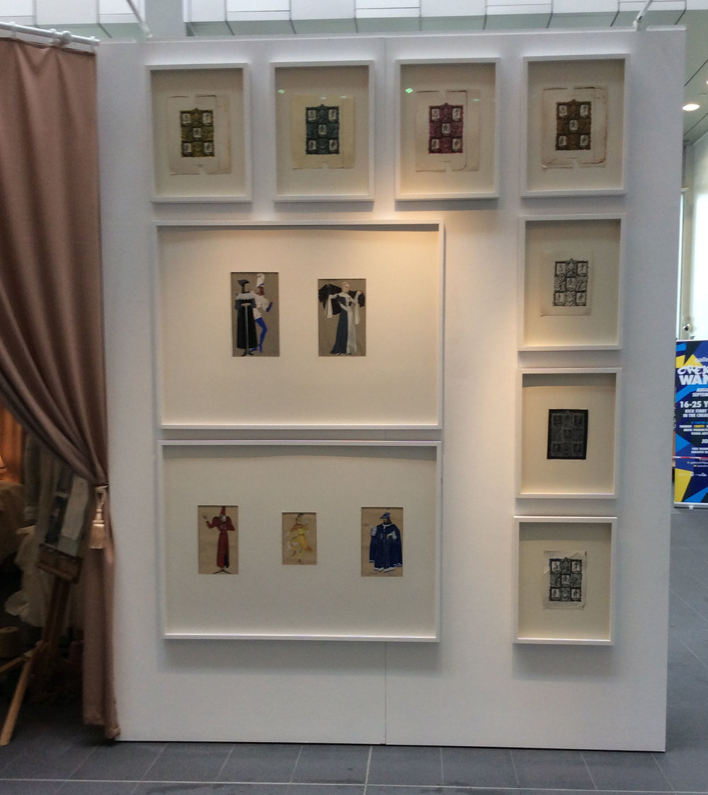 Installation shot of Cabinets of Costume exhibition showing designs for a book cover and theatrical costume designs by Meredith Hawes, 1930s, from BCU's Art & Design Archives, Parkside Gallery, May 2017.