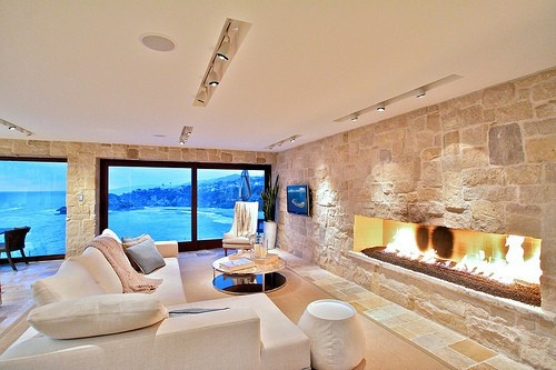 The size and scale of this fireplace is great... and the view out the window's not bad either!