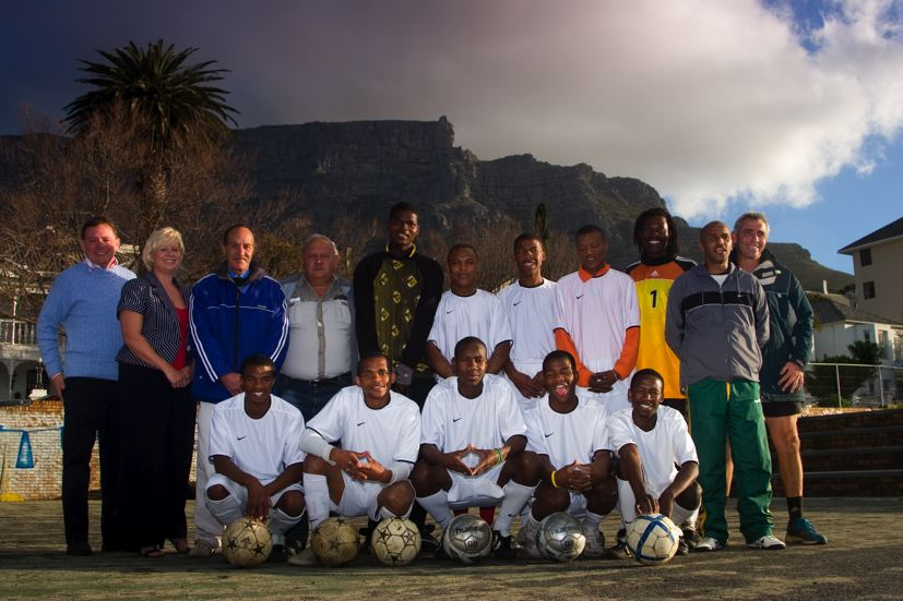 The South African squad for the Homeless World Cup '09 with Penny Streeter, managing director of the A24 Group