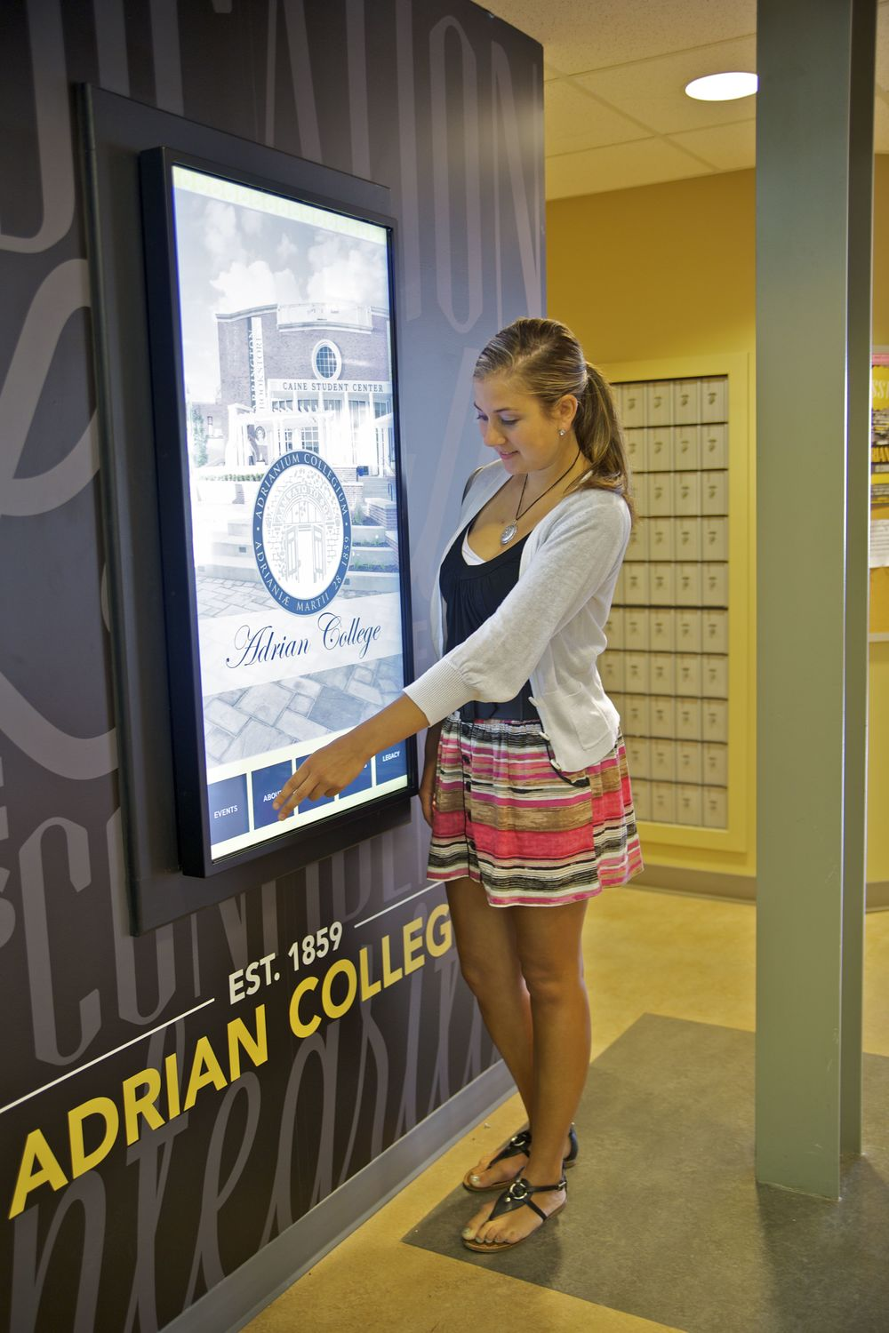 A student using the new digital sign.  Photo Credit: Michael Neal