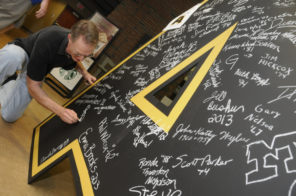 "Alums signed the ""A"" in Caine Student Center (formerly Ridge Gymnasium).   Photo Credit: Michael Neal"