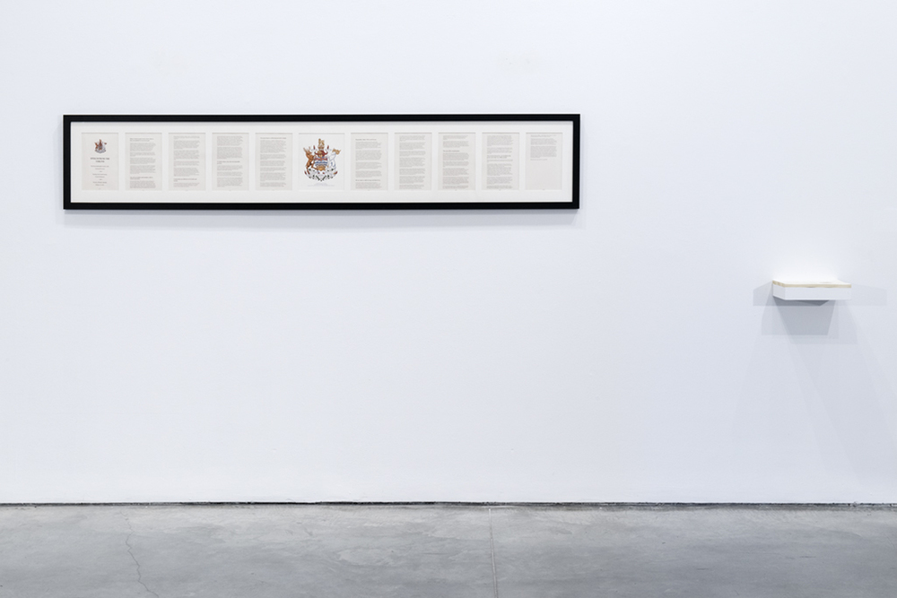 """Framed document with copies for take away. 10 8.5 x 11 pages, official Provincial crest. 90"""" W x 14"""" H. Exhibited at Charles H Scott Gallery, Vancouver, BC. July 2015."""