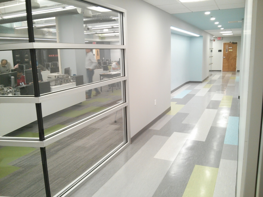 ... VCT tile in a staggered linear pattern ties back in to painted Tectum
