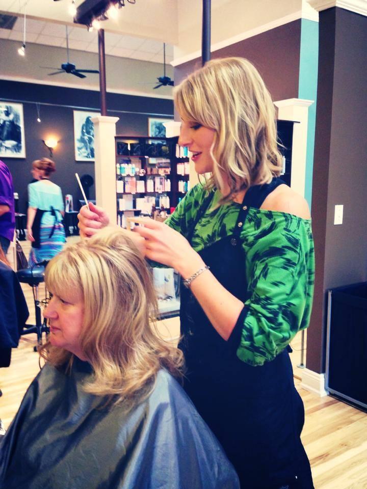 Advanced Designer Kelly demonstrating a hair teasing method
