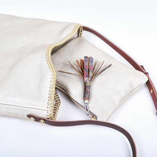 This beauty is a current favorite in the shop.  Our Outsider Crossbody Bag in Platinum Lambskin Leather with Gold Lacing is stunning, soft and the size is just right for your springtime outings.. hello lamby!! Springtime swooning over here!  made in Tucson by @themellowdawn . . . . . . .  #ilovemast #mercadosanagustin # #tucsonboutiques #tucsonrules #masttucson #shoplocal #shopsmall #boutique #tucson #desertstyle #style #styleguide #greatgifts #madeintucson #classic #supportlocal #handmade #travelstyle #formandfunction #leatherbags #leathergoods #leathergifts #golden #perfectbag