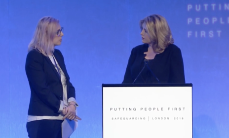 Alexia Pepper de Caires (left) disrupts UK Minister Penny Mordaunt's keynote speech at the International Safeguarding Summit.  (Photo: Screenshot of DFID International Safeguarding Summit)