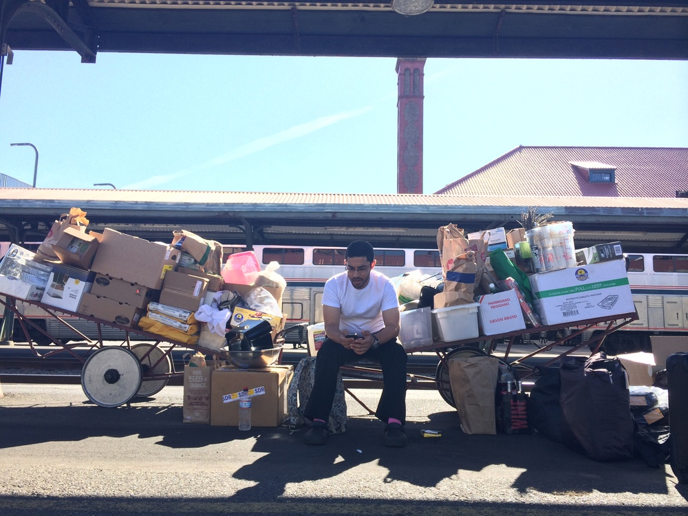 8/7/14  |Our on-train chef Christian Ortiz outside Union Station in Portland, Oregon with the first day's load of provisions.