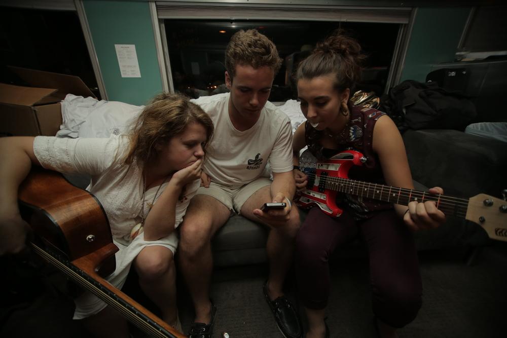 8/10/14  |Elizabeth Jarrett, Chris Dowd, and Ayla Boyle in the on-train hacker space turned jam space.