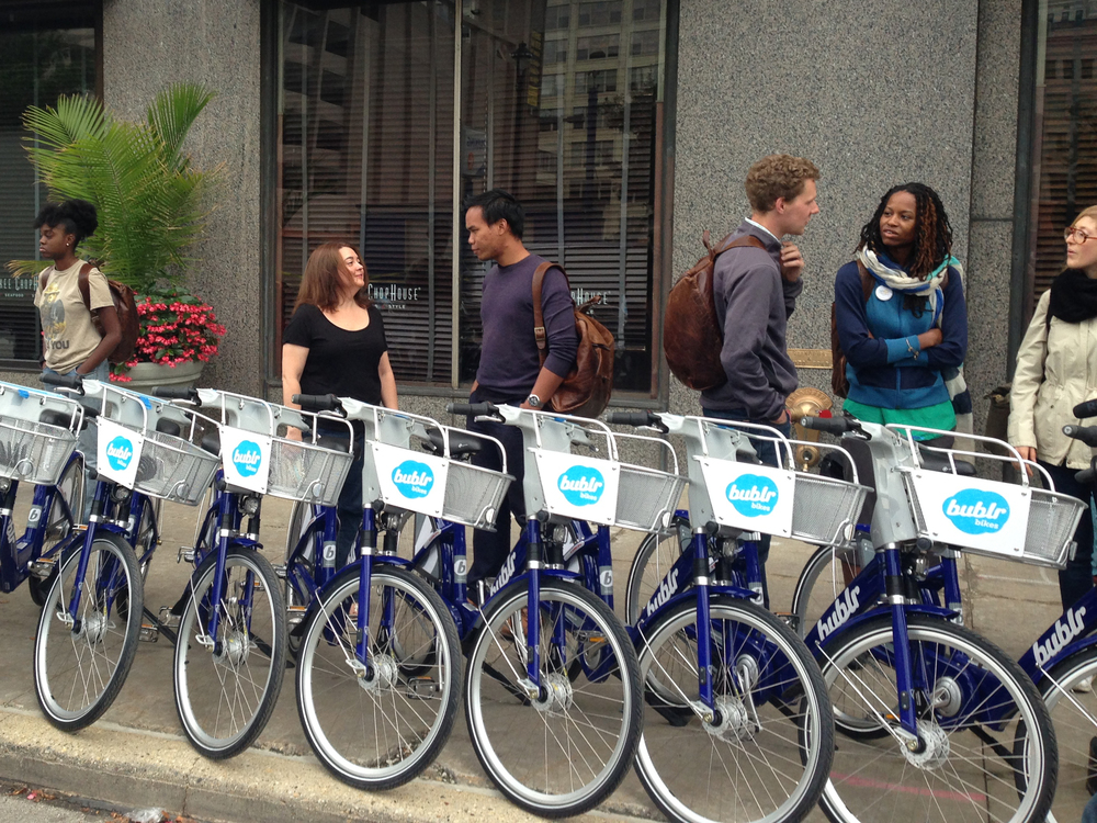 NEWaukee, a social architecture firm in Milwaukee, organizes a day of lectures from local leaders and museum tours in Milwaukee. Transport is provided by Milwaukee bike share system, Bublr.