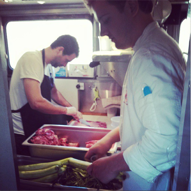 8/10/13  | Our on-train chefs, Sam and John, cooking up yet another delicious meal with locally-sourced ingredients from our most recent stop.