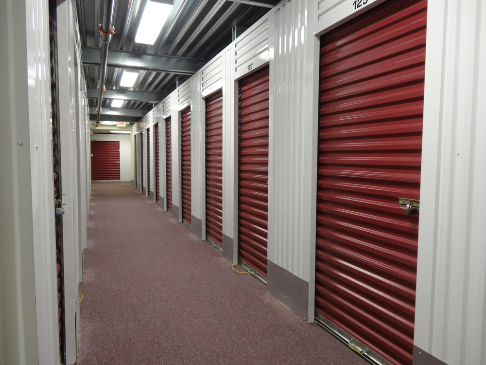 The entrance is located between units 143 and 147. Squared Away Storage & Squared Away Storage