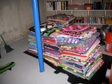 190 quilts ready to go to the 2013 Hole in the Wall Gang Summer Camp (Comfort Quilt Chairman has a big basement!  Thank Goodness!)
