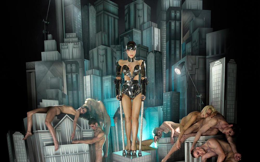 """Plague of an Ancient City"" by David LaChapelle for Lady Gaga's  Fame Monster   album art. Annie lies stricken atop the skyscraper on the left."