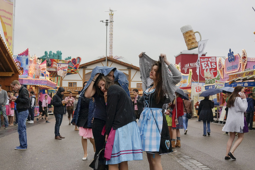 A rainy day at the Stuttgarter Frühlingsfest.It is the largest springfestival in Europe. Stuttgart. Germany. 2013 © Peter van Agtmael/Magnum Photos