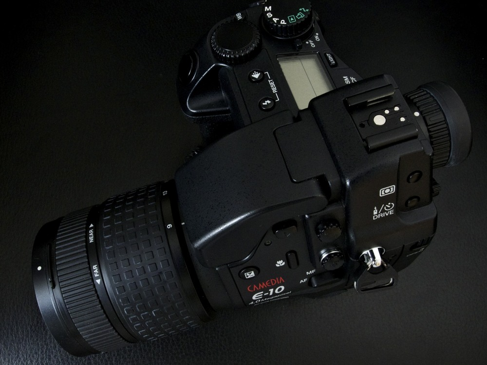 Released in 2000, the robust fixed-lens (equiv.35-140mm) metal-bodied E-10 was a prosumer, metal-bodied zoom lens reflex with TTL finder and was the first true 4MP digital camera in the market