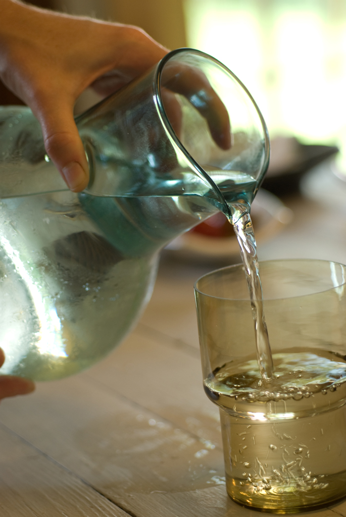 pouring glass vase kitchen.jpg