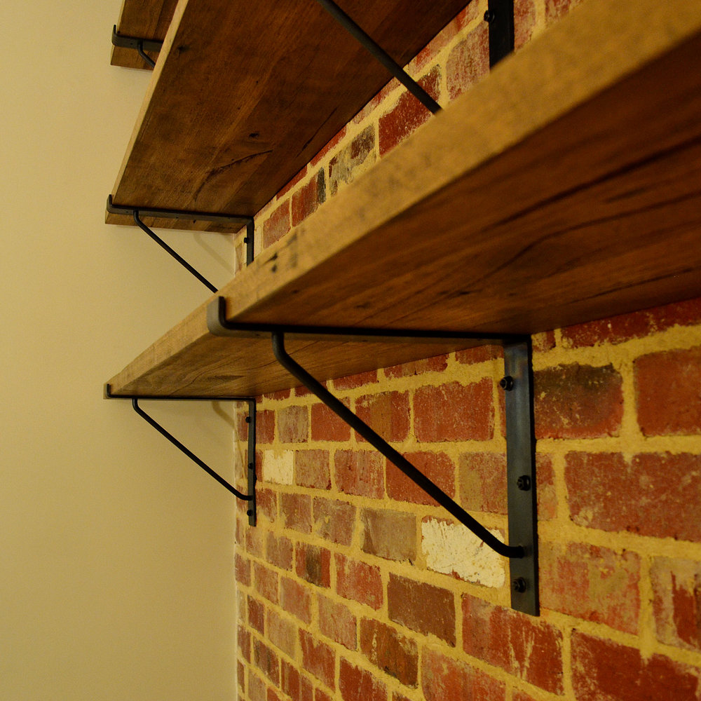 Custom Steel Shelf Brackets On Brick Wall
