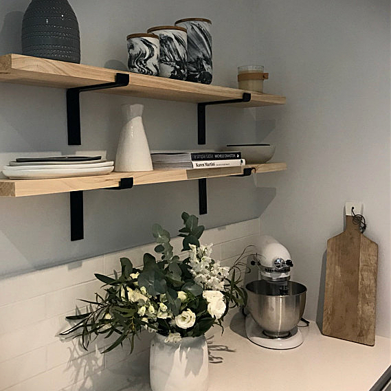 Shelf Bracket On Kitchen Wall With Flowers