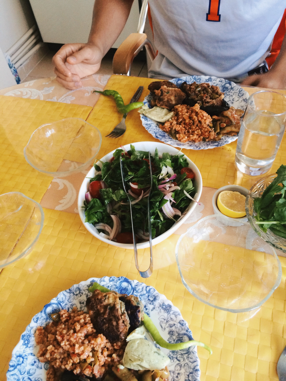 The beautiful food we gorged on our second day in Turkey containing shepards salad, fresh peppers, cress, fava, dolma, mücver and more.