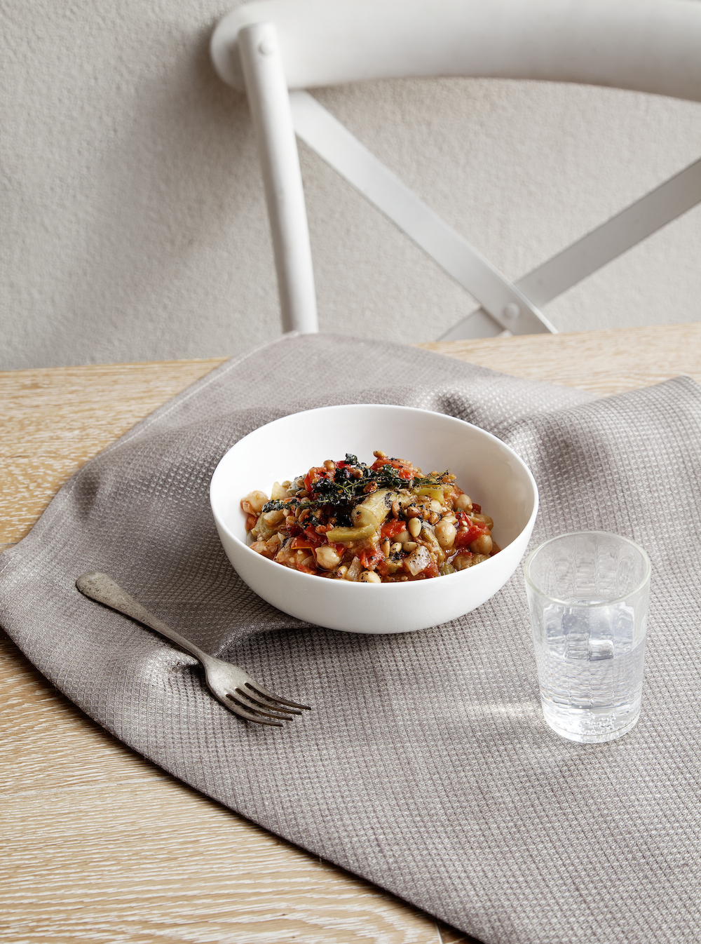 Bamya (Turkish Okra Stew). Photography by  Elisa Watson , Styling by Kate Bradley &  Elisa Watson . Kitchen Cloth in Washed Waffle Grey from  Fog Linen . Bowl, fork and glass found in an op shop. // Kenkō Kitchen