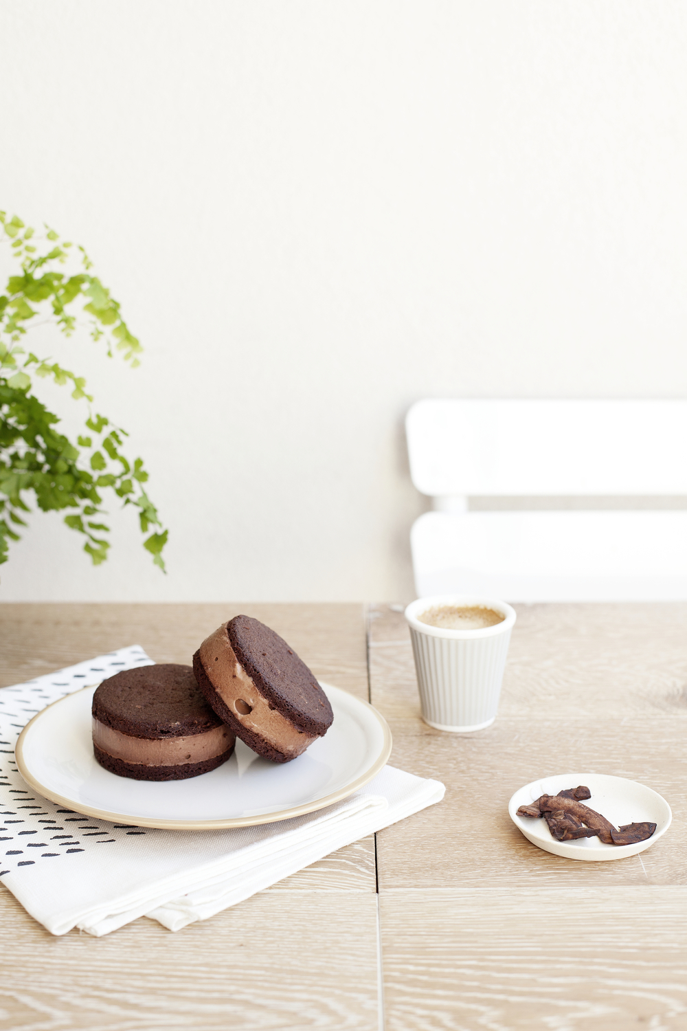 Kenkō Kitchen Ice Cream Sandwiches. Tea towel by  Spin Spin . Small cup and plate from Merci Paris. Large plate from Op Shop. Styling by  Kate Bradley , Photography by  Elisa Watson .