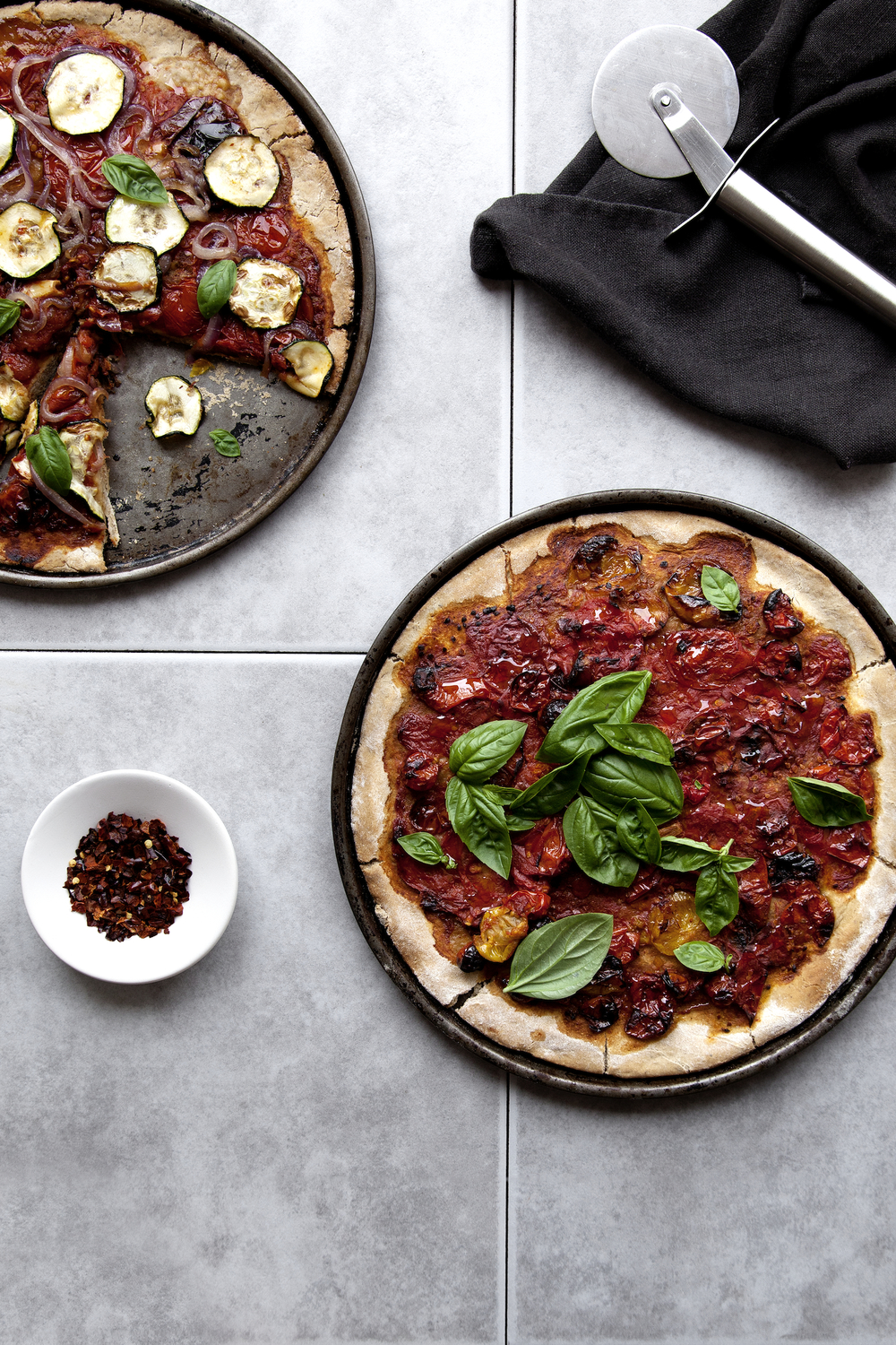 Homemade Pizzas  // Kenkō Kitchen. Image taken from the Kenkō Kitchen Cookbook.   Australian edition   out now through Hardie Grant, out March/April through Hardie Grant UK and Rizzoli USA. Photography by  Elisa Watson , styling by Kate Bradley (Kenkō Kitchen) and Sally Bradley.