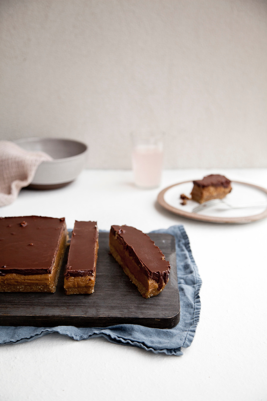 Caramel Slice // Kenkō Kitchen. Image taken from the Kenkō Kitchen Cookbook. Cookbook out now through Hardie Grant/Rizzoli. Photography by Elisa Watson, styling by Kate Bradley (Kenkō Kitchen) and Sally Bradley.