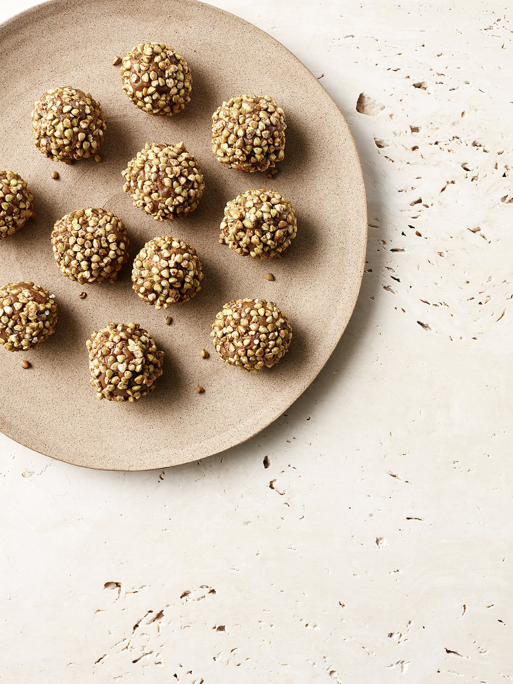 Golden Funtime Balls // Kenkō Kitchen. Image taken from the  Bliss Bites  Cookbook. Cookbook out December 1st through Hardie Grant. Photography by  Elisa Watson , styling by  Caroline Velik .