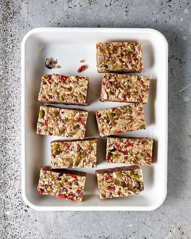 "Anyone who knows me, knows I'm like an annoying bird just snacking on things all day. 🤷🏼‍♀️ I quite often feel sorry for my desk mates as I'm always crunching almonds, a carrot or something equally loud/annoying whilst constantly announcing ""I'm soooo fungry today!"" as if it's not a daily occurrence (forever fungry). These raw seed bars are a real filler-upperer though and they put me at bay for at least a couple of hours. If you're also partial to the ol' snack and you've been looking for something insanely delicious, raw and healthy that will fit with your bird lifestyle, try these! 🐣 Recipe in the Bliss Bites cookbook. 📷 @elisawatson_photography / @carolinevelik @lanewayfoodstudio"