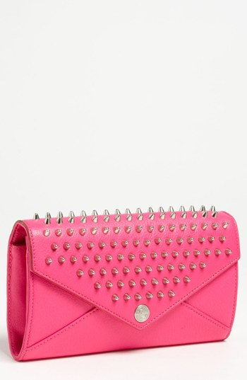 Rebecca Minkoff Studded Wallet on a Chain, $225. Great cross body bag to carry your essentials with a pop a color!