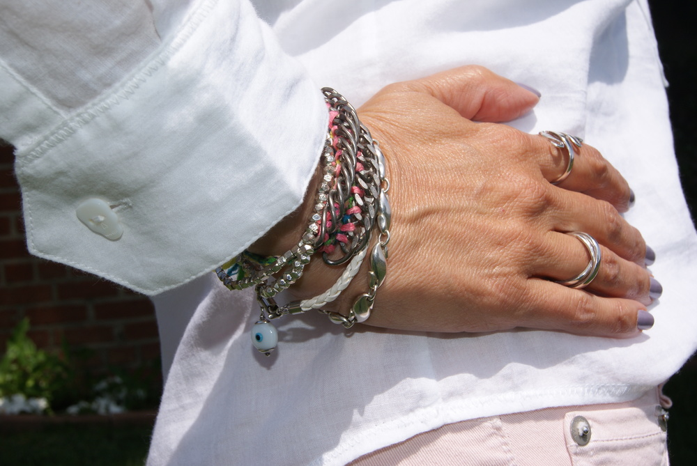 Skull button detail and mix of bracelets including a  Dannijo friendship bracelet  and one by  Elsa Peretti for Tiffany.