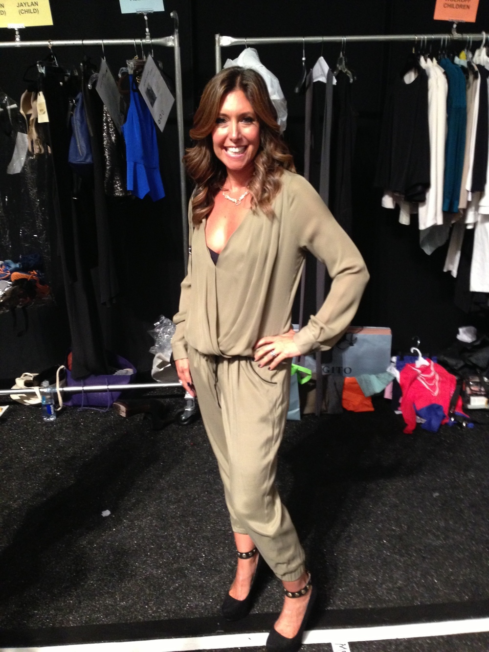 Back Stage: All dressed and ready to strut the runway! Pants and top by  Ramy Brook.