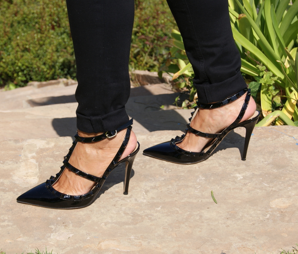 Valentino Rock Stud pump: Side view. Worn with black jeans (cuffed to show the stud details).