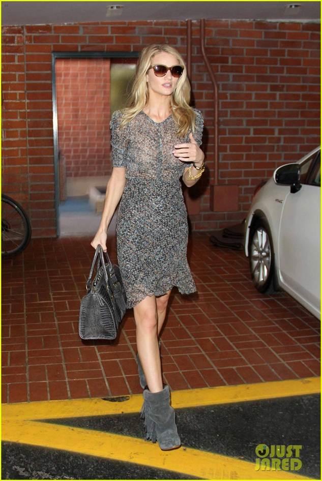 Rosie Huntington-Whiteley wearing Isabel Marant for H&M Dress,$129.00 Isabel Marant for H&M Boots,$299.00