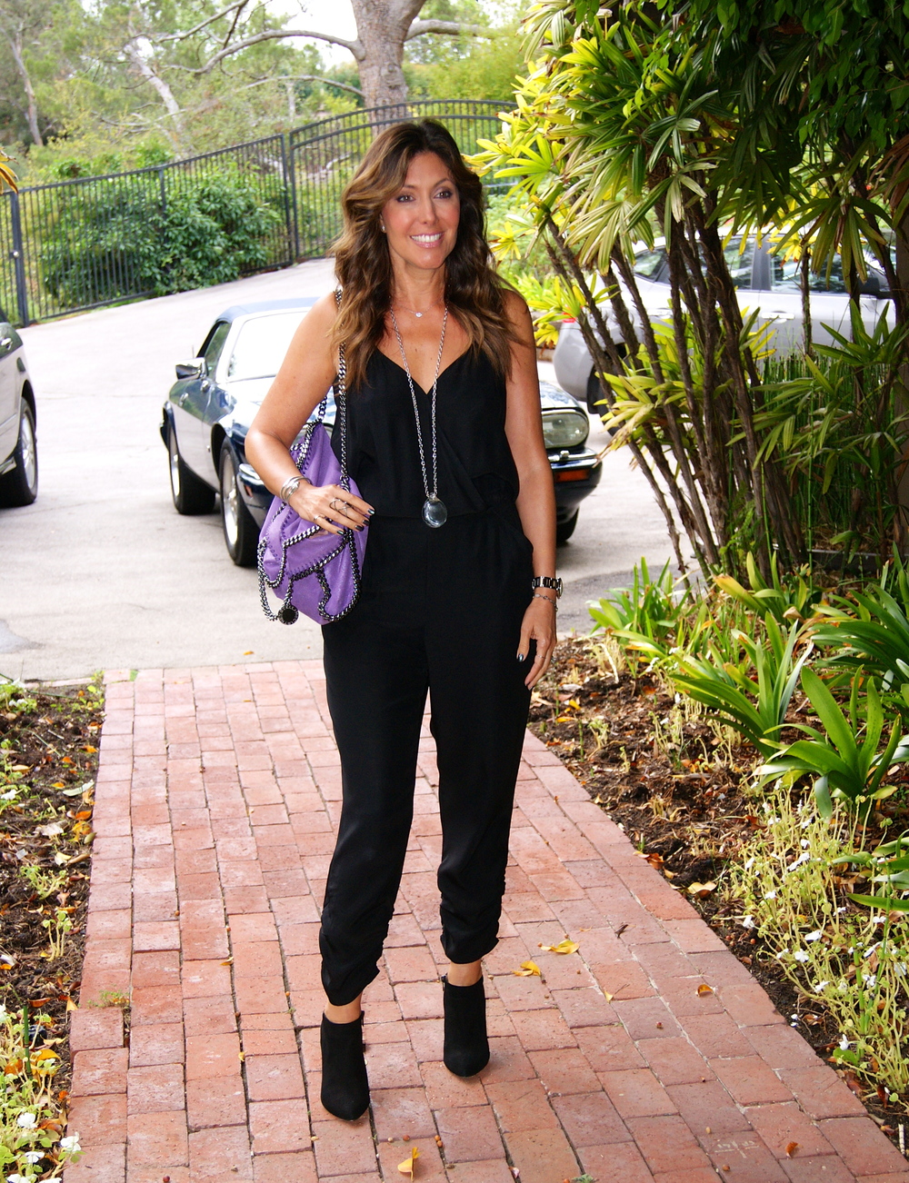 Black Silk Jumpsuit: Parker (no longer available)   Falabella fold-over Bag: Stella McCartney, $1195    Black Pura Lopez Low Cut High Heel Booties- $410