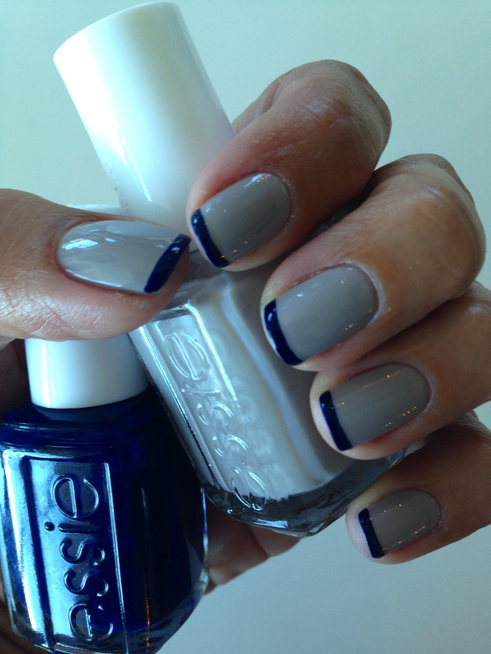 Nail color shown:  Take It Outside, $8.50. Blue Tips: Style Cartel, $8.50.     Both shades   from the new Fall 2014 collection by essie.
