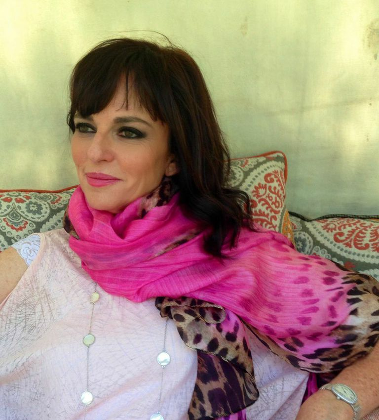 Founder and Global Curator, Esther Feder wearing Essie Collection pink leopard scarf and long mother of pearl necklace.