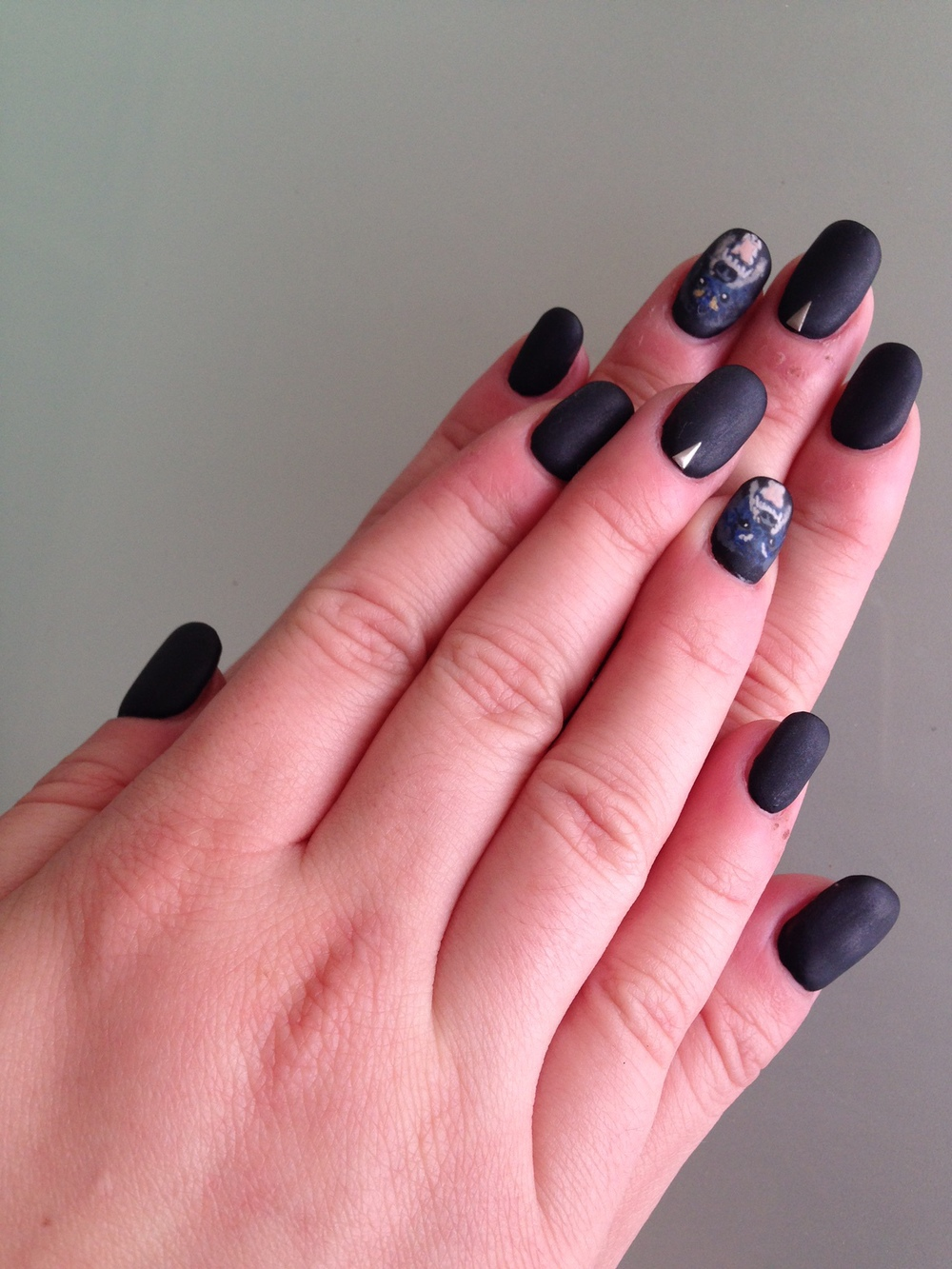 Matte gel manicure shown with Givenchy dog accent nail.