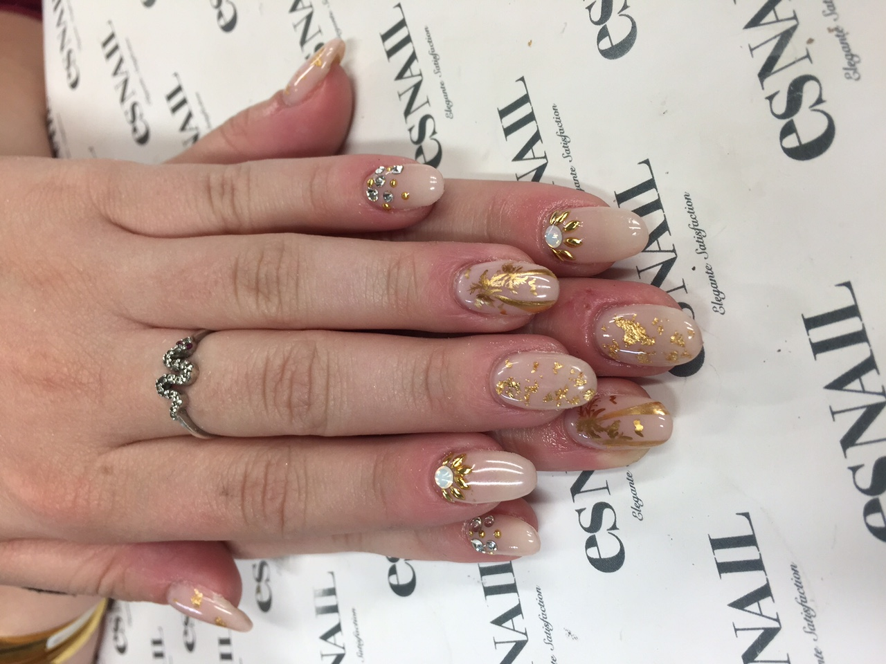 Natural nail with stones, gold and glitter. Hand model Rachel Meyers.