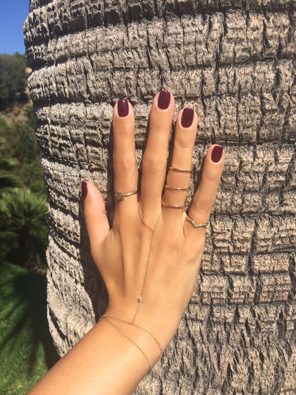 Hand chain, pyramid and pinky chevron ring available at XIV Karats in Beverly Hills. Gold midi and stacked ring are from the Brentwood Farmer's Market in Los Angeles. See below to purchase similar items online!