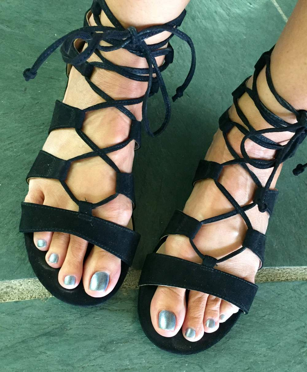 Nail color:  Côte Polish No. 95 , $16.00. Sandals are from  TopShop . These sandals are almost sold out--you can order similar ones  here .