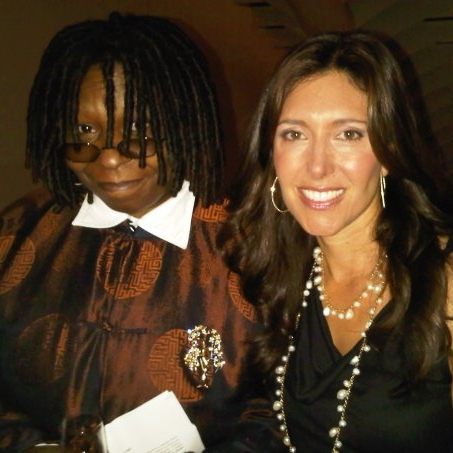 With Whoopi Goldberg at a movie screening