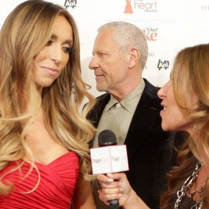 Interviewing  Giuliana Rancic on the red carpet at the Heart Truth Red Dress runway show