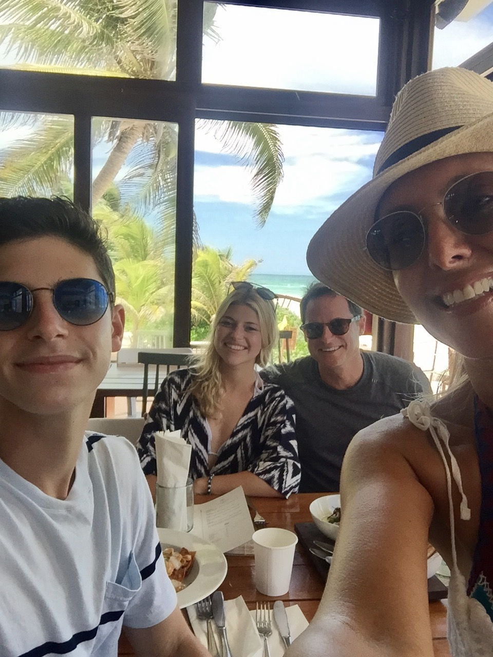 With my family eating lunch at Sanara Tulum sporting our new Berensford Sunglasses.