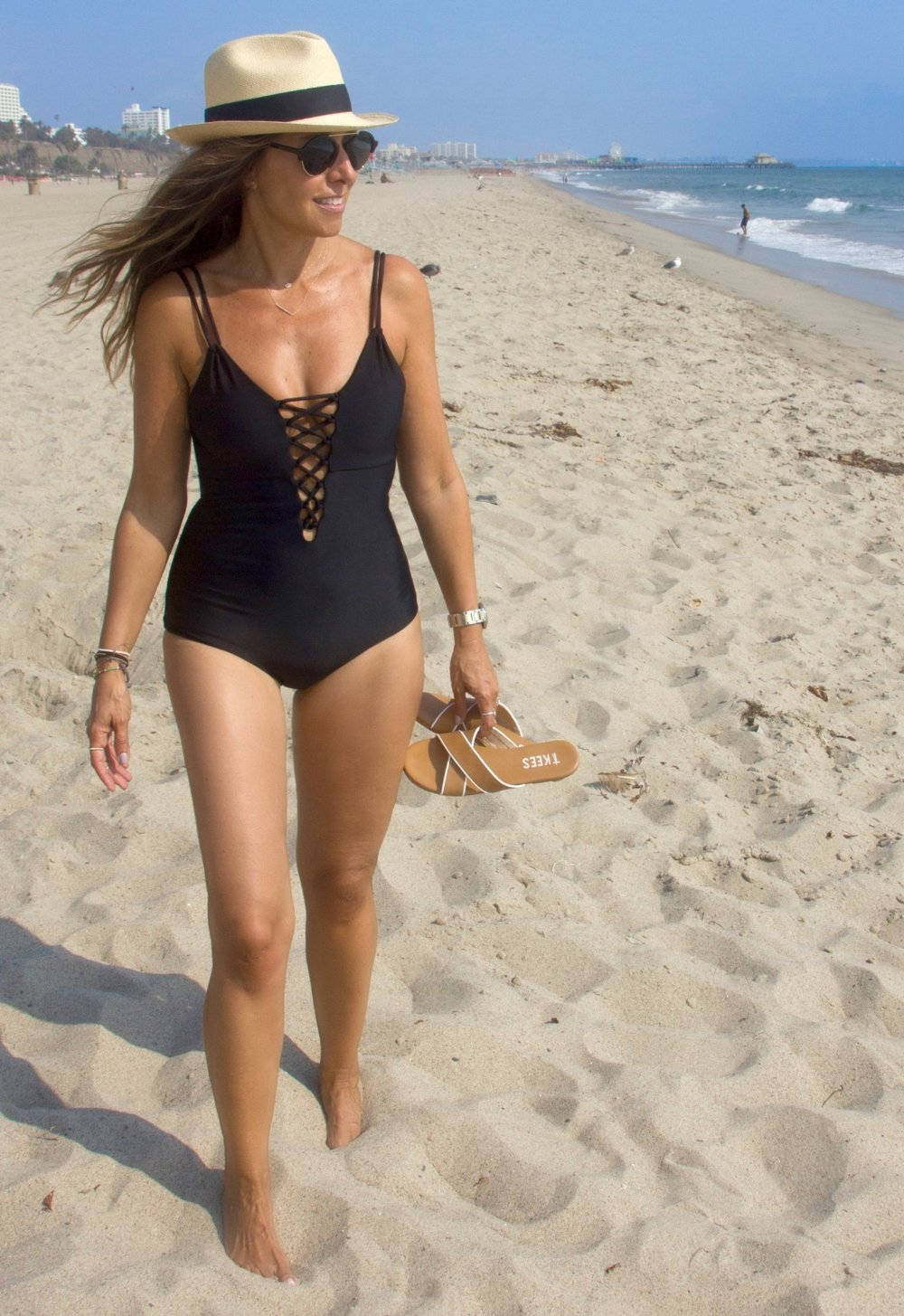 Cami & Jax one-piece . Beach shoes by  Tkees .